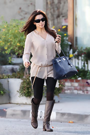 Eva Longoria tackled the polished street style in a pair of chocolate leather riding boots.