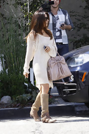 Eva Longoria kept her street style casual with a pair of tan suede tripe buckle boots.