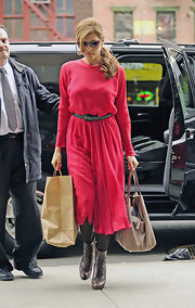 Eva Mendes opted for a flowing red dress with black belt for her daytime look in NYC.