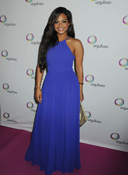 Christina Milian chose an elegant purple gown with a full pleated skirt for her red carpet look.