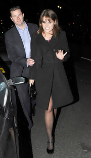Princess Eugenie topped off her winter style with black patent leather Mary Jane pumps.