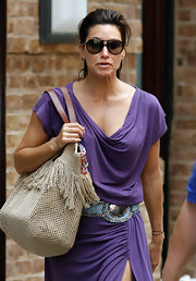 Gina Gershon hid her eyes behind a pair of designer shield sunglasses as she took a stroll in New York.