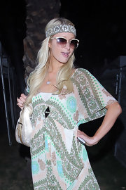 Paris poses for the cameras at Coachella in a pair of stylish shades.