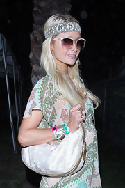 Paris wears a bohemian-chic headband with her hippie ensemble at Coachella.