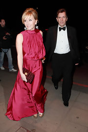 Joanne McCue attended the Noble Gift Gala looking too glam in her fuchsia colored frock. She matched her floor-length gown to her patent leather clutch.
