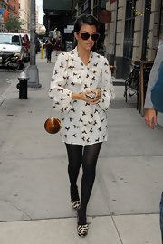 Kourtney was out and about NYC in an ultra chic ensemble. She accessorized her look with the wooden round 'Aime' clutch.