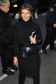 Nina Garcia's black fringe belt and skirt added some whimsy to the editor's classic black look.