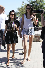 Kendall Jenner channeled the '60s in a white fringed tank and micro mini denim cutoffs.