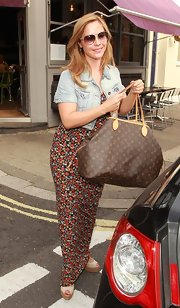 Showing off her printed maxi dress, Heidi added a classic spin to her casual look with a monogram canvas tote.
