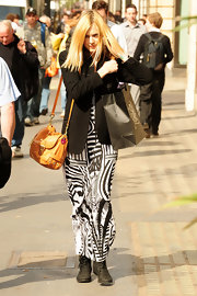Fearne Cotton toughened her graphic print maxi dress with black suede lace up boots.