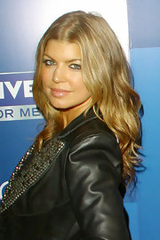 Fergie attended the 'Look Like You Give a Damn' event sporting long center part curls.