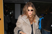 Fergie of the Black Eyed Peas jets into London's Heathrow airport direct from New York.