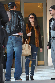 Fergie shows off her superfly look, with these oversized sunglasses and fur vest that are a throwback to the 70's.