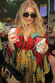 Fergie showed off her bright turquoise mani, which was just perfect for a tropical trip to Rio.