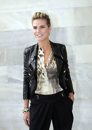 Heidi showed off her cropped jacket while hitting the Roberto Cavalli fashion show in Milan.