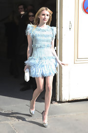 Emma Roberts added a classic touch to her Chanel fashion show attire with an angular white satin diamond clutch.