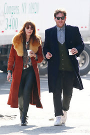 Florence Welch is known for her hippie-inspired style like this fur-trimmed duster, which she wore while walking through NYC with a friend.
