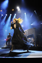 Florence performed onstage in this gorgeously gothic black tulle gown.