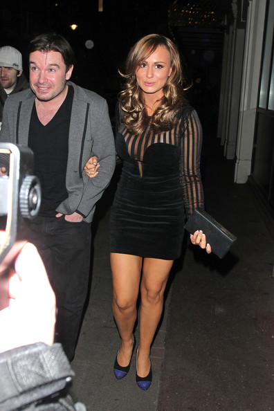 Chanelle paired her sheer LBD with a black leather hard case clutch.