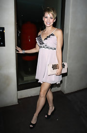 Kimberly Wyatt paired her soft pink dress with a matching envelope clutch.