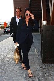 Fran Drescher wore an oversize navy blazer with fitted cigarette pants in a matching color.