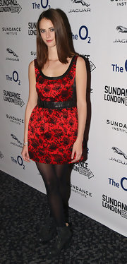 Kaya Scodelario contrasted her sweet dress with a pair of rugged black lace-up boots.