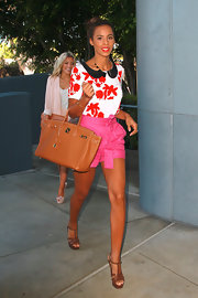 Rochelle Wiseman sweetened her style with a floral print peter pan blouse and fuchsia shorts.