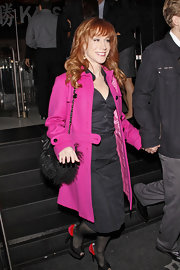 Kathy Griffin added interest to an all black look with a hot pink coat.