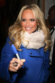 Kristin Chenoweth bundled up in a fur scarf while leaving 'Live! With Kelly.'