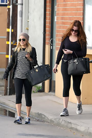 Well of course Khloe totes a Birkin to the gym! But wait: There's Nicole Richie, who also worked out in Hermes style!