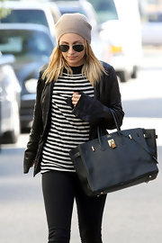 Nicole Richie carried her black leather Hermes tote to the gym.