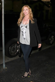 Shannon Tweed was seen out in Katsuya wearing a plunging tank top.