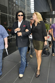 Shannon Tweed was seen carrying an ostrich tote while out with her husband Gene Simmons.