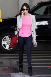 Genesis Rodriguez was spotted at LAX wearing a pants and tee ensemble and a pair of wedge leather sneakers.
