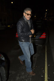 George Clooney chose a deep gray leather jacket for his look while heading out to dinner in London.