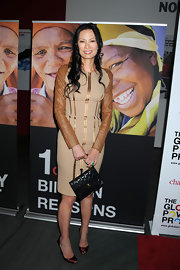 Wendi Deng stepped out at the Global Poverty Project in a fitted dress and a pair of satin peep-toes.