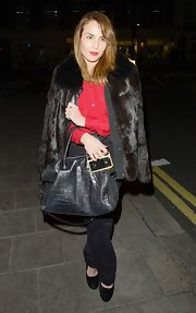 Noomi Rapace enjoyed a night out in London carrying a black croc-embossed cross-body tote.