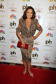 Tia Carrere looked sassy in a cowl-neck leopard-print dress with sleeve cutouts at the 2012 Miss USA Pageant.