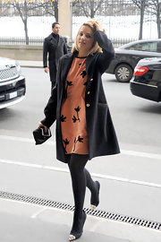 Dianna accessorized with cap-toe stilettos.