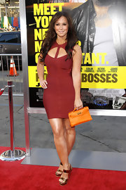 Jennifer Love Hewitt paired her form fitting bandage dress with a mini Birkin bag in a poppy orange hue.