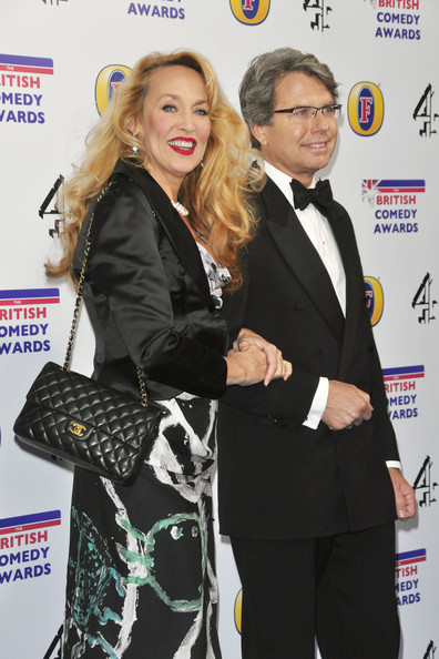 Jerry Hall attended the 2011 British Comedy Awards carrying a classic black quilted leather Chanel bag with gold hardware.