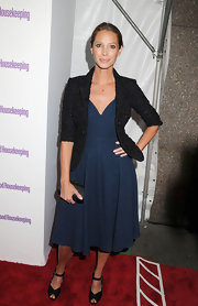 Christy Turlington looked oh-so-sweet in a blue cocktail dress with a full skirt and deep sweetheart neckline.