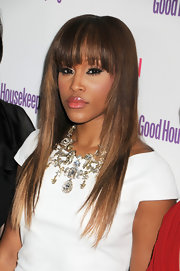 Eve showed off her stylish cut at the 'Good Housekeeping' Shine On event with pin straight tresses and wispy bangs.