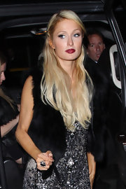 Paris Hilton went out for the evening wearing a glossy rich cranberry lipstick.