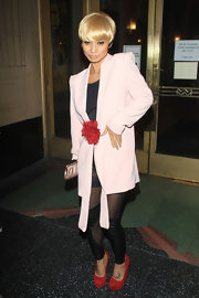 Bai Ling arrived for the opening night of 'Billy Elliot' wearing a pair of red suede platform wedges that exactly matched her fluffy flower pin.