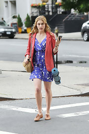 Greta Gerwig completed her look with a pair of tan Oxfords.