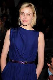 Greta Gerwig was a mix of cool colors at the Cynthia Rowley fashion show with this metallic purple belt and blue dress combo.