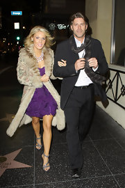 "Gretchen Rossi hit the premiere of ""The Fighter"" in glamorous rhinestone embellished strappy sandals paired with a fur trimmed coat and purple cocktail dress."