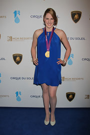 Missy Franklin paired her Olympic gold medal with a royal blue, layered dress.
