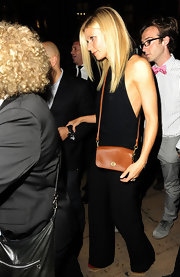 Gwyneth Paltrow was classic chic in a black jumpsuit at the Coach Fashion Night Out soiree in London. She paired the look with a simple tan cross-body bag.